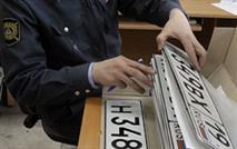 Высокопоставленный полицейский попался на торговле номерами, фото 1