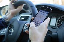 За разговоры по телефону за рулем предложили лишать прав, фото 1