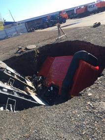 Два КамАЗа на парковке провалились под асфальт, фото 2