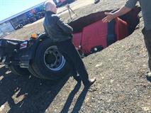 Два КамАЗа на парковке провалились под асфальт